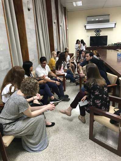 OU students talking with Cuban medical students
